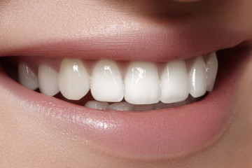 Beautiful smile with whitening teeth. Dental photo. Macro closeup of perfect female mouth, lipscare rutine