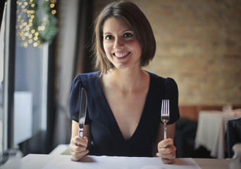 Hungry woman at the restaurant