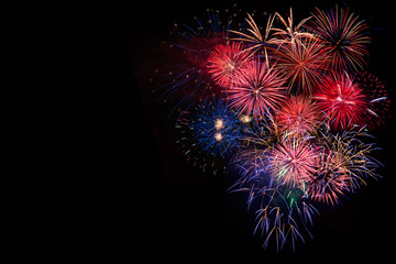 Amazing colorful festive bright celebration fireworks, salute with dazzling display in the night sky background. A large fireworks event. Sparks. 4 of July, Independence day, New Year. Copy space