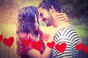 Composite image of cute couple hugging under the rain
