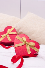 gift boxes with heart shape in the bedroom