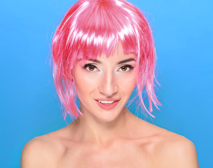 Portrait of beautiful young woman with pink hair on a blue background
