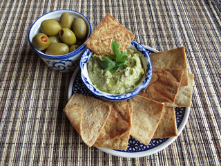 Snacks with olives and hummus