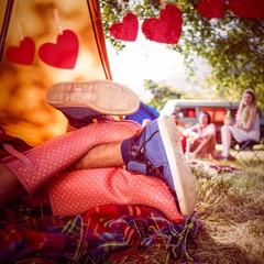 Composite image of young couple making out in tent