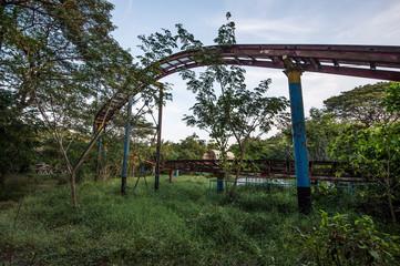 Rusty roller coaster tracks at Yangon abandoned amusement park