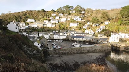 Wall Mural - Elevated view of English harbour Polperro Cornwall South West England UK smooth professional video pan
