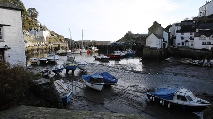 Wall Mural - English harbour Polperro Cornwall South West England UK out of season in winter with boats at low tide
