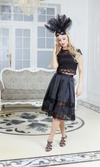 stylish elegant blonde woman in beauty rich interior, wearing black dress smiling