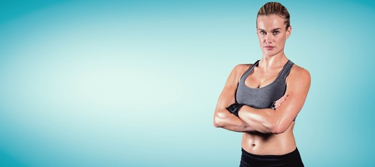 Composite image of muscular woman with arms crossed