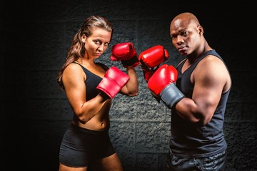 Male and female athletes with boxing gloves
