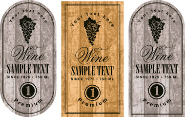 set of wine labels with grapes on the background of wooden boards