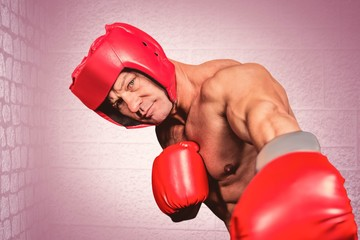 Boxer with gloves punching against camera