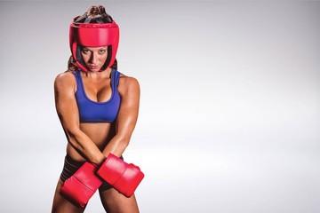 Composite image of portrait of fit female boxer