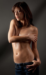 Topless Woman in Jeans and Body Oil