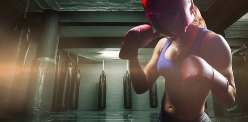 Female fighter with fighting gloves
