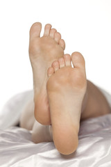 bare female feet on white