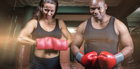 Male and female boxers with fighting gloves