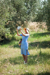Woman taking nature shots with touch pad
