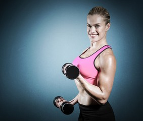 Composite image of muscular woman lifting heavy dumbbells