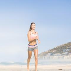 Composite image of fit woman jogging