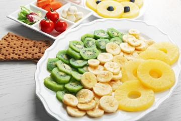 Fruits and vegetables on light wooden background. healthy eating concept.