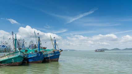 Thai wooden fishing boats in harbor, Thailand