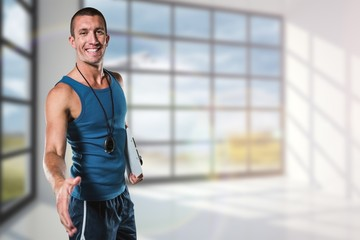 Composite image of happy personal trainer giving handshake