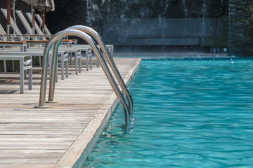 Metal staircase to the entrance to the swimming pool