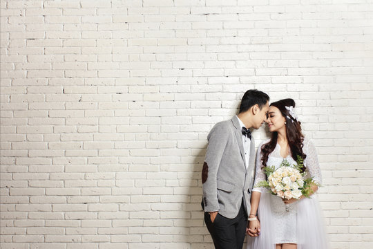 lovely asian newlywed couple
