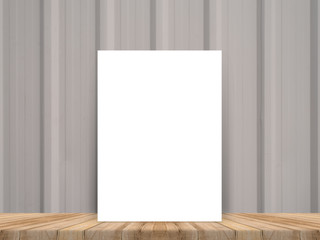 Blank white poster leaning at tropical wood table top with plank wood wall,Mock up background for adding your content