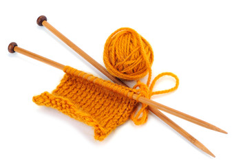 Yellow yarn of knitting with needles and ball