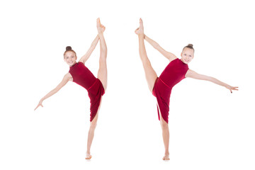 Two dancer girls doing standing splits