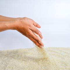Rice Grains Fall Hand
