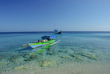 fishing boat over the coral