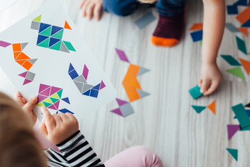 Kids playing with geometric shapes