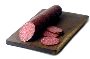 Slices of salami on white background
