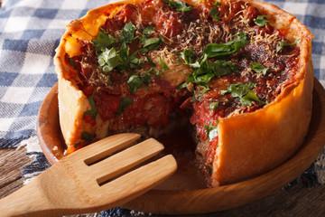 Printed kitchen splashbacks Ready meals Sliced Chicago style deep dish pizza closeup on a plate. horizontal