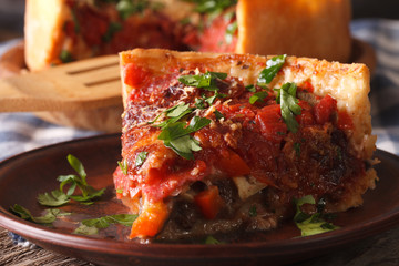 Wall Murals Ready meals Slice of Chicago deep dish pizza on a plate macro. Horizontal