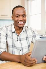Handsome man using tablet