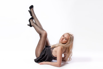 Beauty woman lying in short black dress and pantyhose