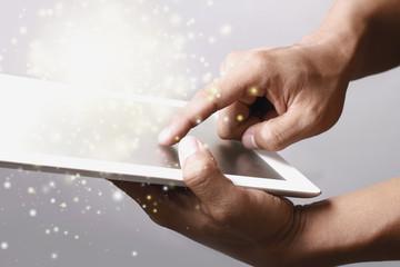 Gold magic stars light on tablet