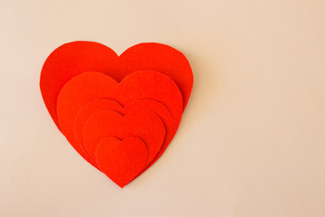 Red paper hearts Valentines day  on white background. Copy space