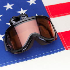 Winter sport goggles over USA flag - studio shot