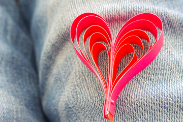 Red paper hearts Valentines day  on  blue jeans. sofe focus