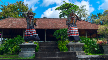 Statues of the gods at the entrance to a temple in Bali, Indones