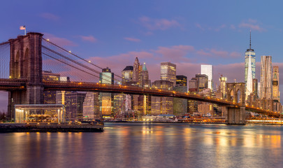 Brooklyn Bridge and Manhattan skyscrapers at sunrise, New York