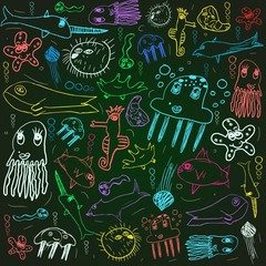 sea animals creatures, child scribbles background on the blackboard