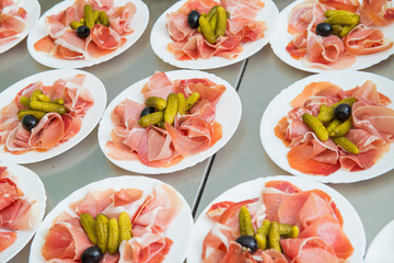 meats on platter. Delicious chopped prosciutto as a starter closeup