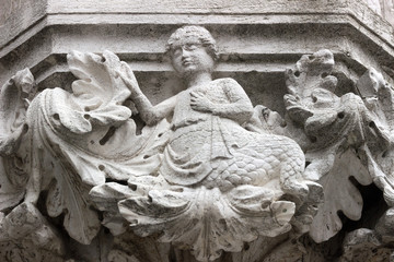 Detail of a capital along the porch of Ducal Palace in Venice