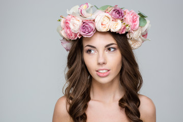 Cute woman with wreath from flowers on head